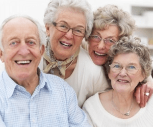 An elderly family consisting of one male and three females who look to be brothers and sisters.